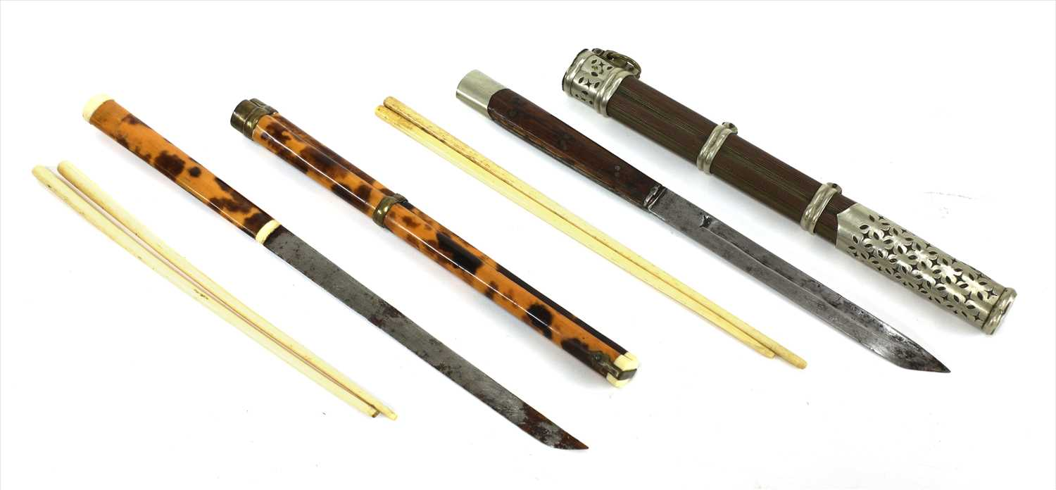 Lot 24-One Japanese tortoiseshell and copper-mounted chopstick cases