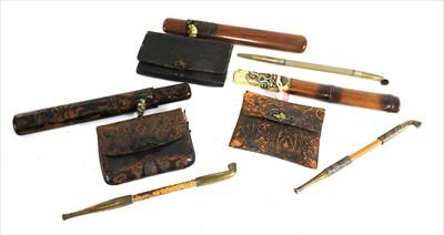 Lot 25-Three Japanese smoking sets, kiseruzutsu (pipecase) with kiseru and tabako-ire (tobacco pouch)