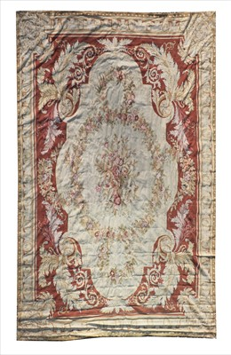 Lot 675 - A large Aubusson needlepoint carpet