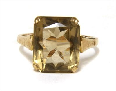 Lot 15-A gold single stone smoky quartz ring