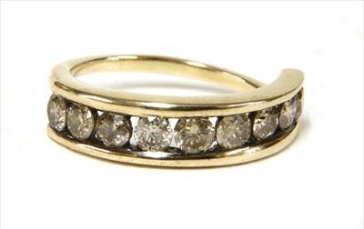 Lot 23-A gold diamond half eternity ring