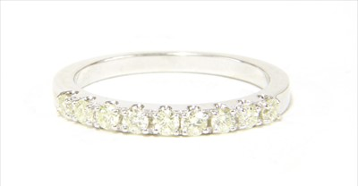 Lot 24-A 9ct white gold half eternity ring