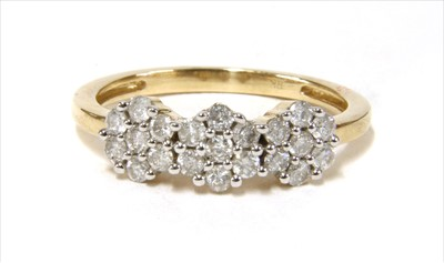 Lot 25-A gold diamond triple cluster ring