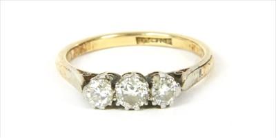 Lot 22-A gold three stone diamond ring