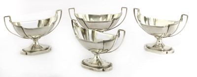 Lot 9-A set of four George III silver salts