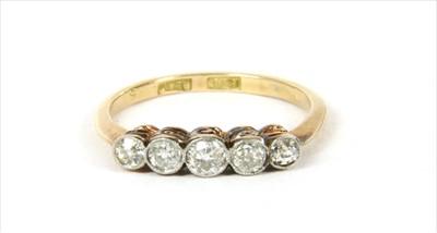 Lot 9-A gold five stone diamond ring