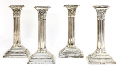 Lot 52 - A set of four silver candlesticks