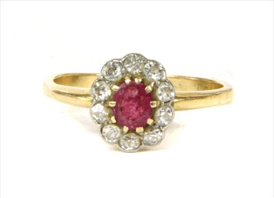 Lot 8-A gold ruby and diamond cluster ring