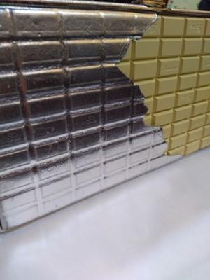 Lot 1024-A Moschino 'white chocolate' clutch bag