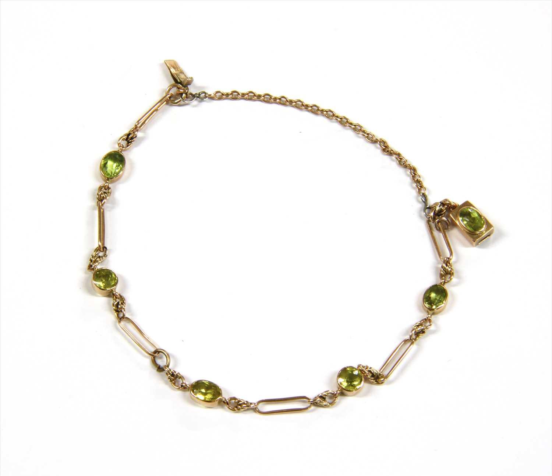 Lot 6-A gold peridot bracelet