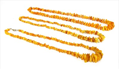Lot 19-Three  graduated butterscotch amber tumbled bead necklaces