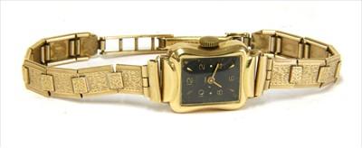 Lot 15-A ladies' gold Anker mechanical bracelet watch