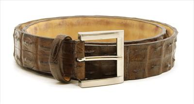 Lot 1141 - A Pickett of London gentleman's brown hornback crocodile belt