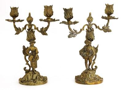 Lot 5 - A pair of Elizabeth II silver gilt figural candelabra