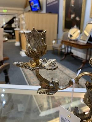Lot 5-A pair of Elizabeth II silver gilt figural candelabra