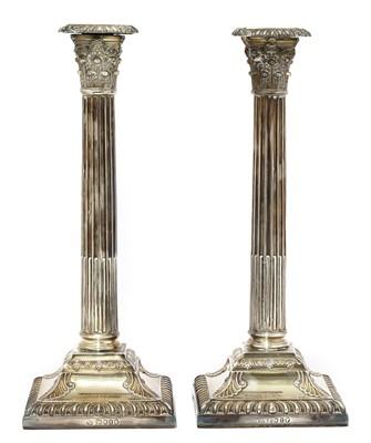 Lot 62 - A pair of Victorian silver Corinthian column candlesticks