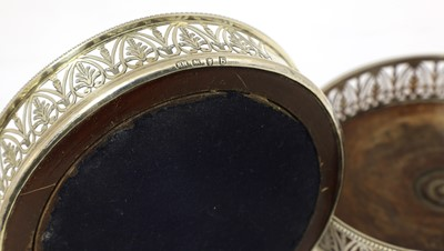 Lot 12-A pair of George III silver wine coasters