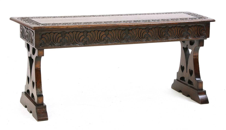 Lot 9 - An Arts & Crafts oak bench