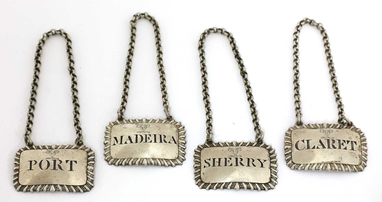 Lot 14-A set of four George III silver wine labels