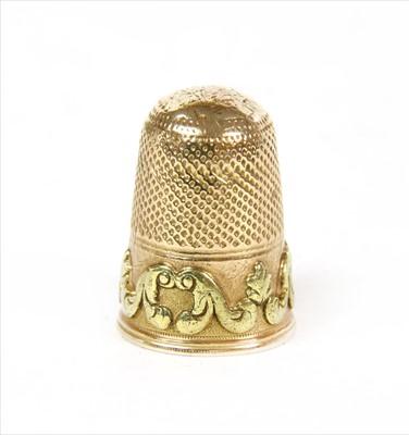Lot 19A-A bi-colour gold thimble