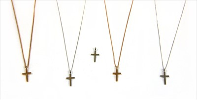 Lot 8-An 18ct white gold diamond cross and chain