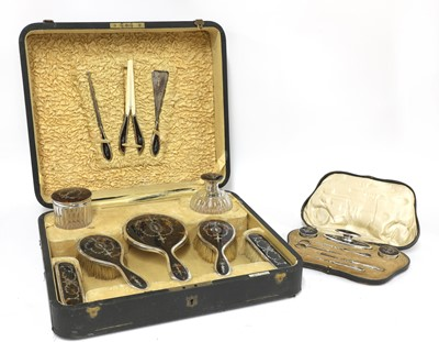 Lot 68 - A tortoiseshell and silver dressing table vanity set