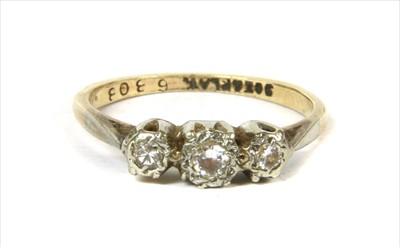 Lot 1-A gold three stone diamond ring