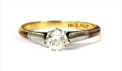Lot 2-A gold and platinum single stone diamond ring