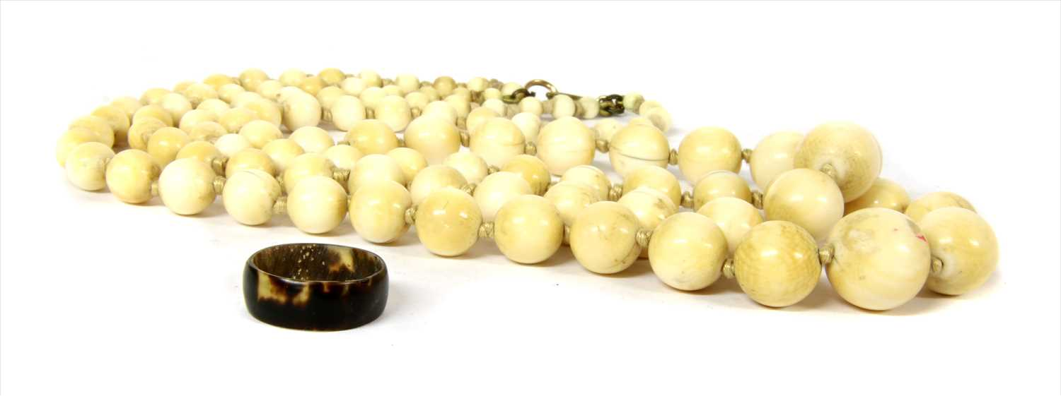 Lot 9-A two row graduated ivory bead necklace