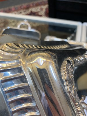 Lot 3-A pair of Georgian silver entrée dishes and covers on heated stands
