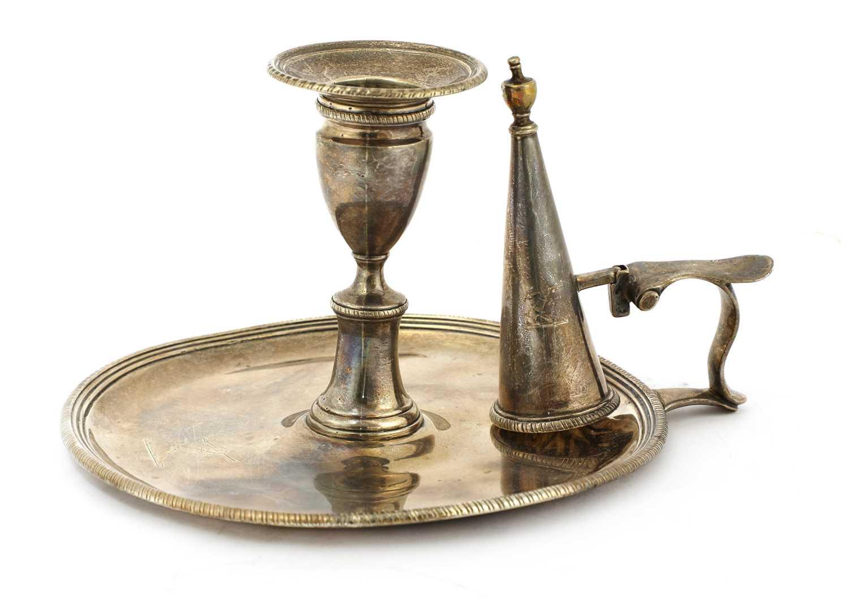 Lot 15-A George III silver chamberstick