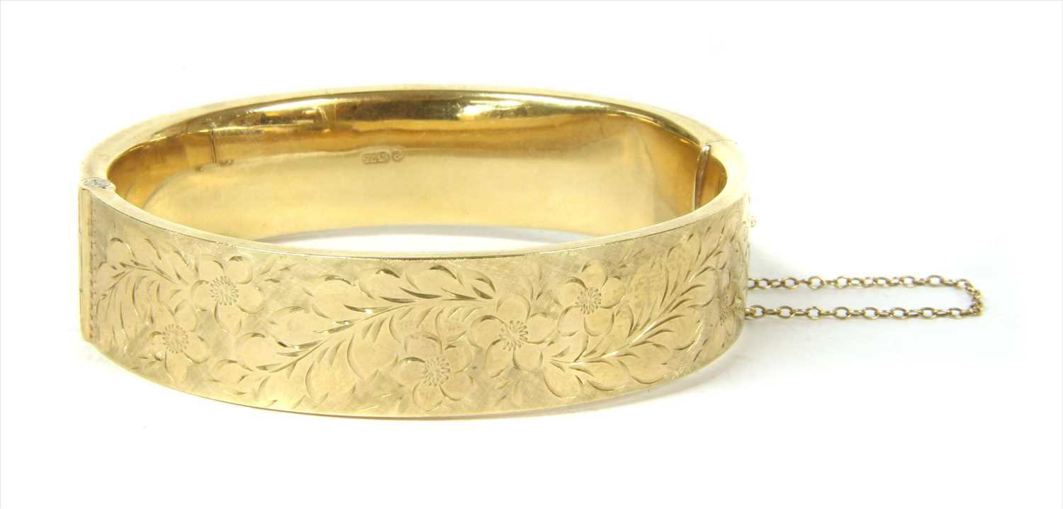 Lot 7-A 9ct gold hollow hinged bangle