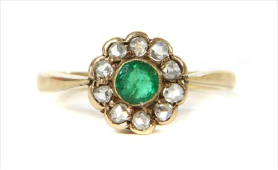 Lot 10-A gold emerald and diamond cluster ring