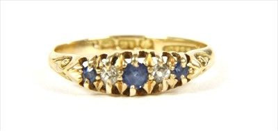 Lot 22-An 18ct gold boat shaped sapphire and diamond ring