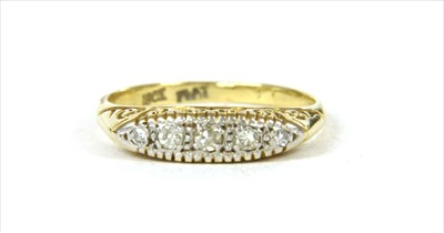 Lot 23 - A gold boat shaped five stone diamond ring