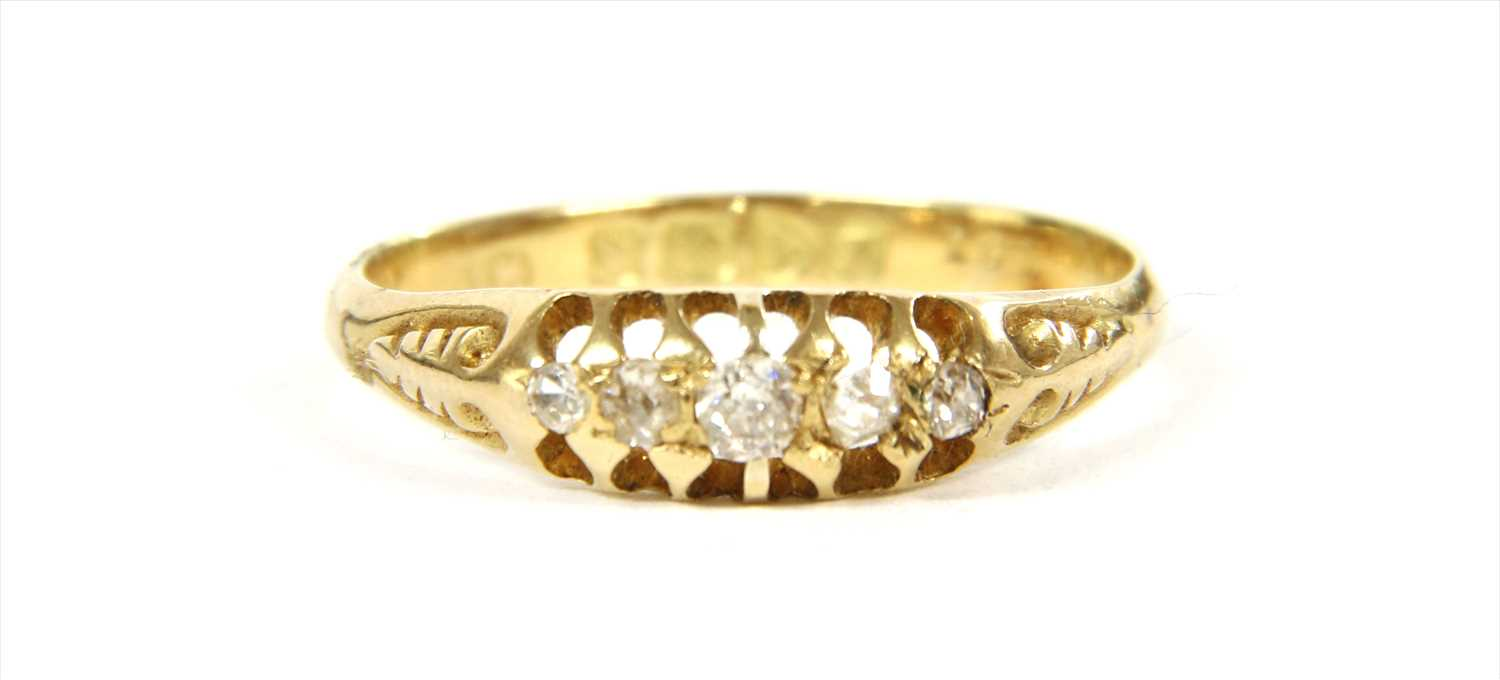 Lot 21-An 18ct gold boat shaped five stone diamond ring