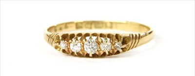 Lot 19 - An 18ct gold boat shaped five stone diamond ring