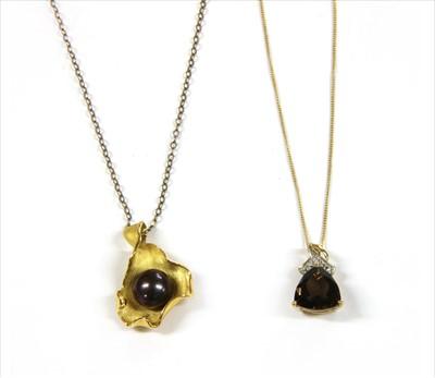 Lot 38-A silver gilt smoky quartz pendant