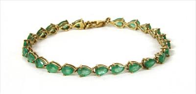 Lot 34-A silver gilt emerald line bracelet