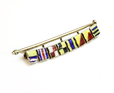 Lot 177 - A gold and enamel signal flag brooch, c.1930