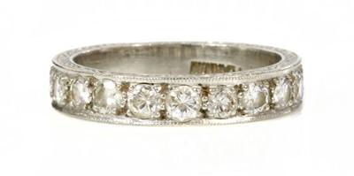 Lot 194 - A platinum diamond set half eternity ring