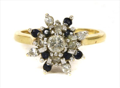 Lot 51-An 18ct gold diamond and sapphire cluster ring