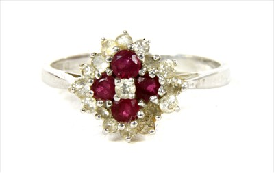 Lot 50-An 18ct white gold diamond and ruby cluster ring