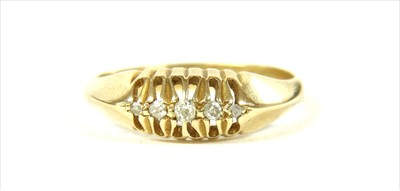Lot 17 - An 18ct gold boat shaped five stone diamond ring