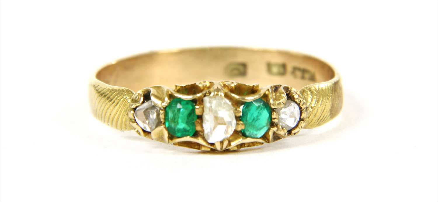 Lot 15-A gold five stone diamond and emerald ring