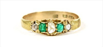 Lot 15 - A gold five stone diamond and emerald ring
