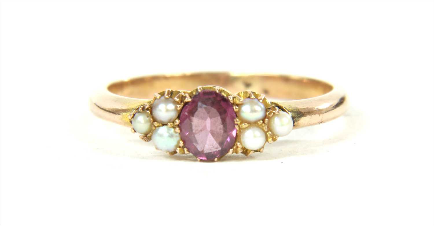 Lot 14-A gold garnet and split pearl ring