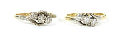 Lot 24-A gold three stone diamond ring