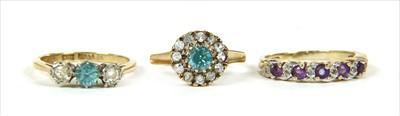 Lot 39-A gold three stone blue zircon and diamond ring