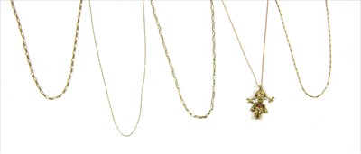 Lot 32-A gold rag doll pendant and chain